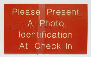 Sign - Present Photo ID